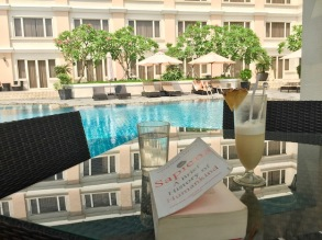 Nothing like reading a book with a cocktail by the pool