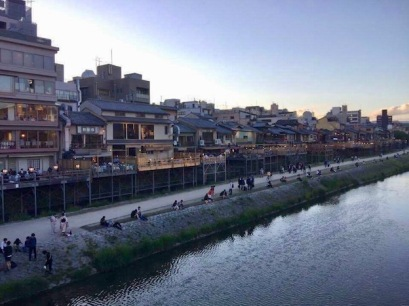 View of the river and bars from the bridge in Gion