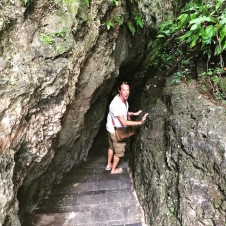 Entrance through cave like rocks to Padang-Padang Beach
