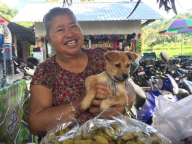 Lovely lady and her puppy at Tirta Gangga